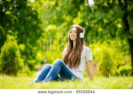 Young Girl Smiling As She Listens To Music