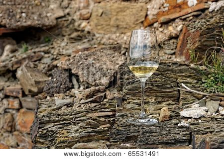 Glass of Riesling wine on a slate rock