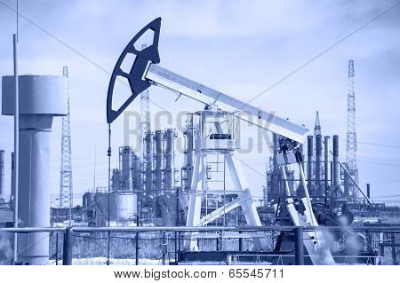 Pump Jack And Oil Refinery.