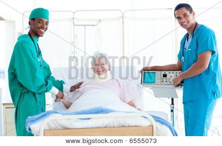 Team Of Doctors With A Patient