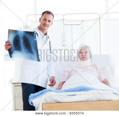 A Doctor Showing An X-ray To A Patient