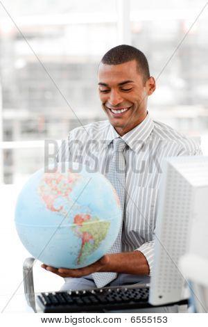 Smiling Businessman Holding Aterrestrial Globe