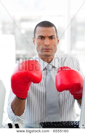 Serious Businessman Wearing Boxing Gloves