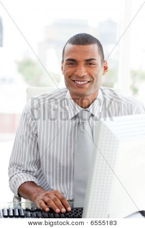 Ethnic Businessman At A Computer