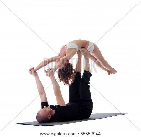 Couple of flexible yogis, isolated on white