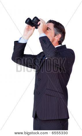 Confident Businessman Looking Through Binoculars