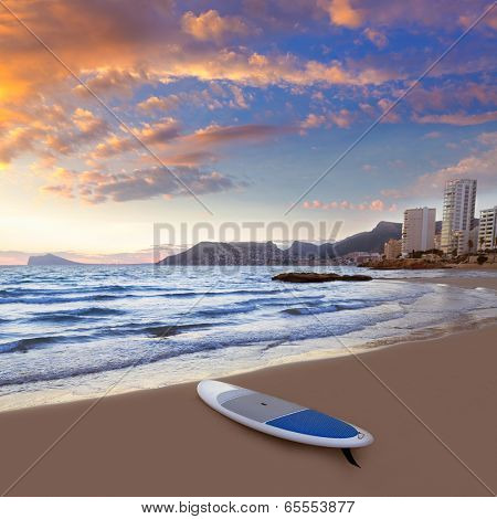Calpe Alicante sunset at beach Cantal Roig in Mediterranean Spain with paddle sufboard