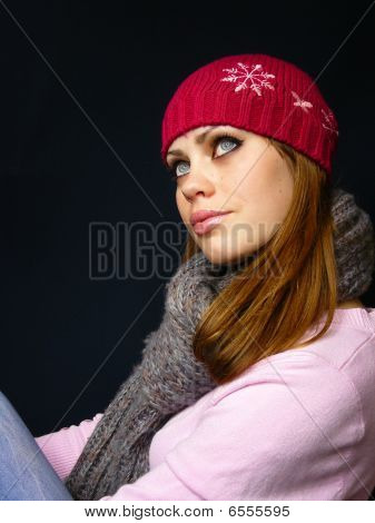 Girl In A Red Cap And A Knitted Scarf
