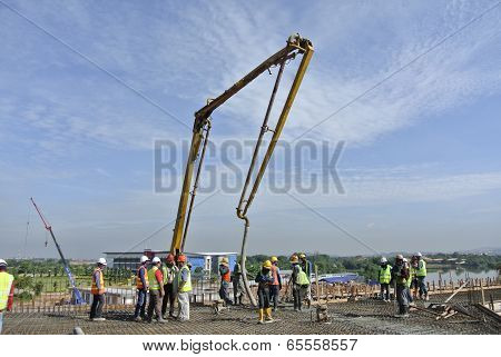 Construction Workers and Elephant Pump