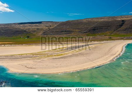 Extremely beautiful bay with mighty golden beaches and turquoise sea in the West Fjords, Iceland. Panoramic photo