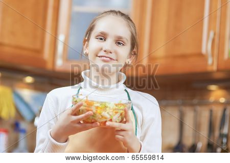 Smiling Teenage Girl Showing The Homemade Organic Vegetable Salad