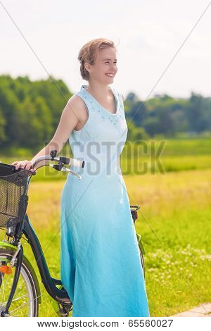 Young Caucasian Blond Laughing Outdoors Standing Near Her Bicycle