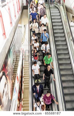 People On A Moving Staircase In Bangkok