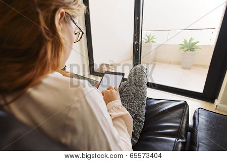 Young Lady Surfing Online On Digital Tablet