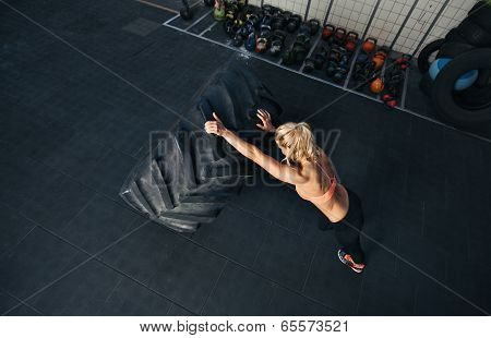 Fit Young Woman Doing Crossfit Exercise