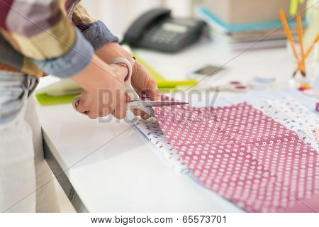 Closeup On Seamstress Cutting Fabric