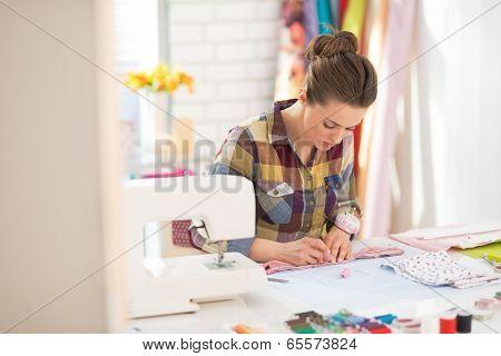 Seamstress Working In Studio