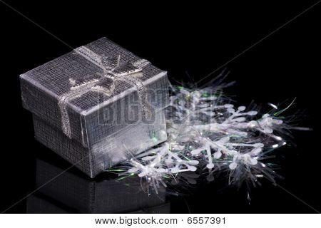 Gift Box And Snowflake