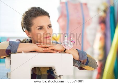 Thoughtful Seamstress With Sewing Machine Looking On Copy Space