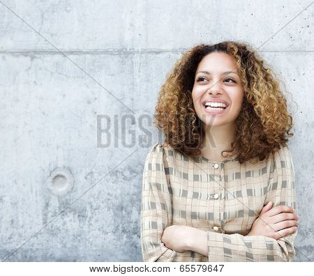 Woman Smiling Outdoors With Arms Crossed