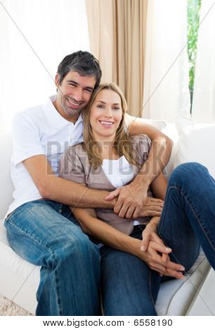 Happy Couple Relaxing On The Sofa