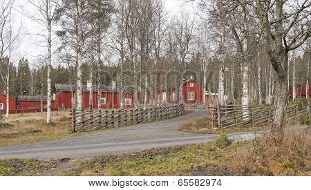 Entry to a wooden homestead in red.