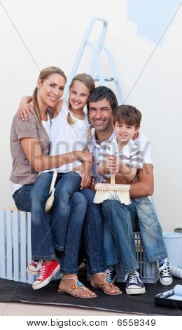Portrait Of A Happy Family Decorating A Room