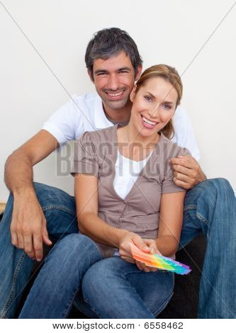 Couple Choosing Color To Paint Their New House
