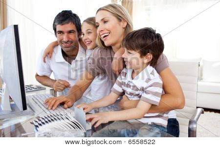 Caring Parents Teaching Their Children How To Use A Computer
