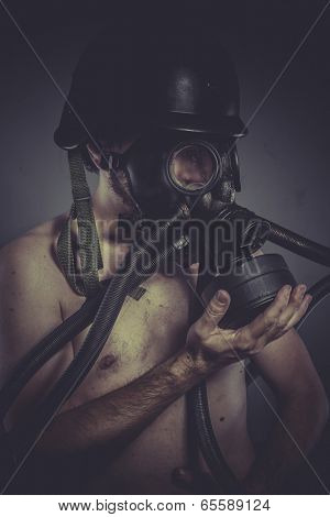 Radiation, nuclear and toxicological disaster ,man with gas mask