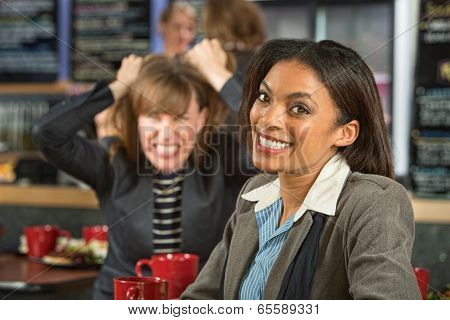 Woman With Frustrated Friend