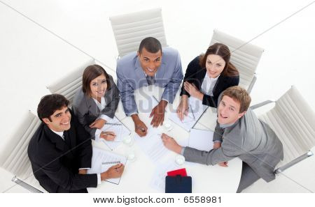 High Angle Of Multi-ethnic Business People Smiling At The Camera