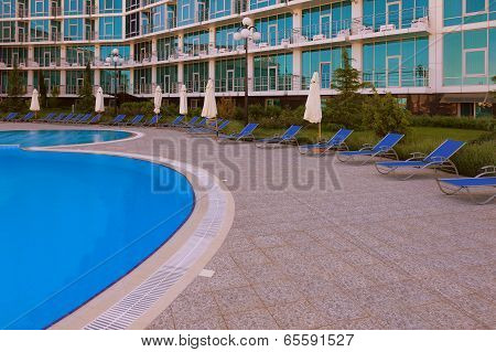 Swimming Pool And Sunloungers