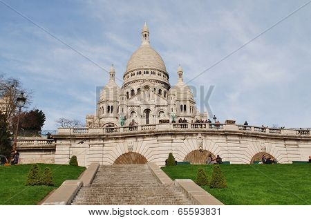 PARIS, FRANCE - MARCH 19, 2014: The Roman Catholic Basilica of Sacre Couer at Montmartre. Designed by Paul Abadie, construction began in 1875 and was completed in 1914.