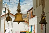 foto of himachal pradesh  - Bronze bells in front of Buddhist Temple - JPG