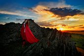 foto of cloak  - beautiful woman with red cloak in the sunset light in spring - JPG