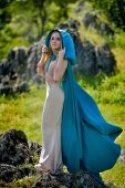 picture of cloak  - beautiful woman with blue cloak posing  outdoor - JPG