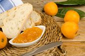 stock photo of loquat  - Freshly picked loquats and some homamade marmalade - JPG