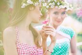 stock photo of nymphs  - Two gorgeous flower nymphs in blooming garden - JPG