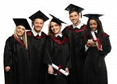 image of white gown  - Multi ethnic group of graduated young students isolated on white - JPG