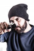 image of gangsta  - a bearded criminal pointing a pistol and wearing a beanie hat isolated over white - JPG