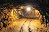 foto of gold mine  - Underground mine tunnel mining industry with light - JPG
