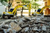 image of crusher  - A Concrete Crusher demolishing reinforced concrete structures