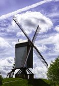 stock photo of dike  - The Bonne Chiere windmill on the dike of Bruges - JPG