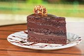 stock photo of fancy cake  - tasty piece of chocolate cake closeup - JPG