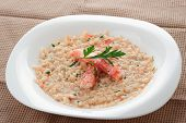 foto of cooked crab  - Risotto with crab meat and herbs in plate - JPG