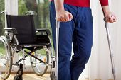 stock photo of crutch  - Horizontal view of a disabled man on crutches - JPG