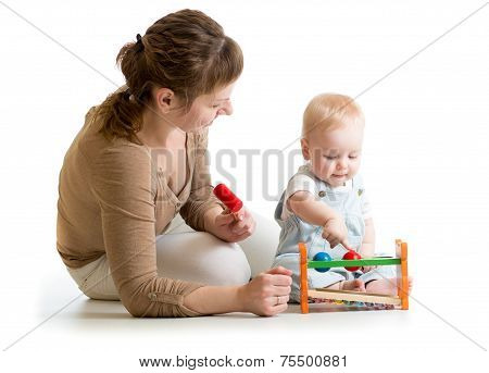 kid and mother playing  with musical toy