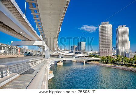 Rainbow Bridge and Sumida River in Tokyo, Japan. This landmark bridge carries many transit lines, as well as vehicle traffic.