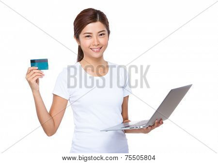 Asian woman use credit card for online shopping